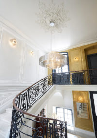 lighting galaxy suspension monumental in paricular mansion stairwell with Eclipse wall lamp Thierry Vidé Design