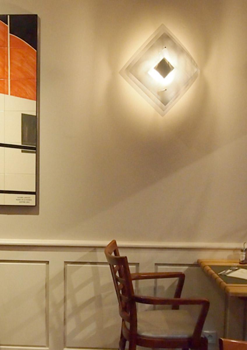 Luminaire applique murale grande Éclipse restaurant Thierry Vidé Design